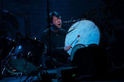 Min Wang Hwang on vocals and percussion. Photo by Mark Anenberg