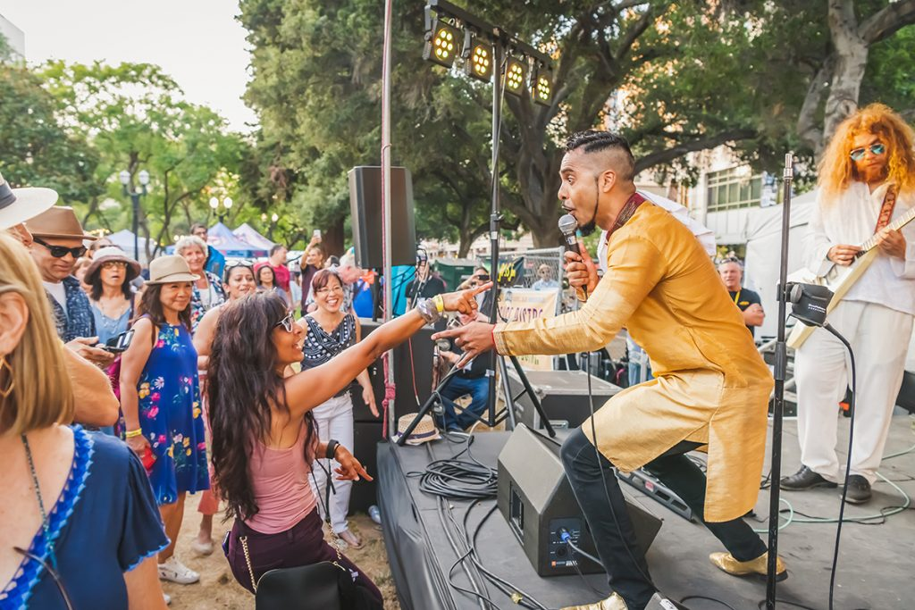 Fest-goer and Aki Kumar connect through music. Photo by Luis Pedro Castillo Pictures