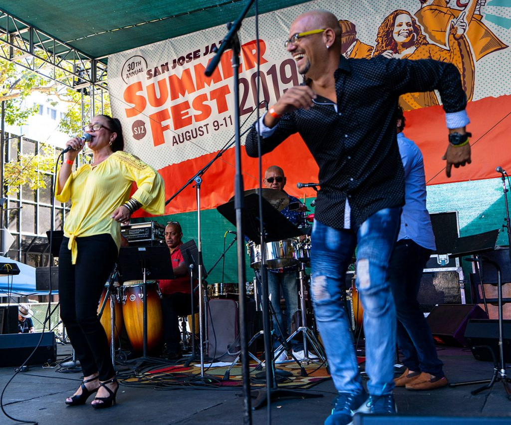 Vocalists Iris Sandra Cepeda and Gonzalo Chomat gave a spirited performance on Saturday's Salsa Stage. Photo by Tom Ehrlich