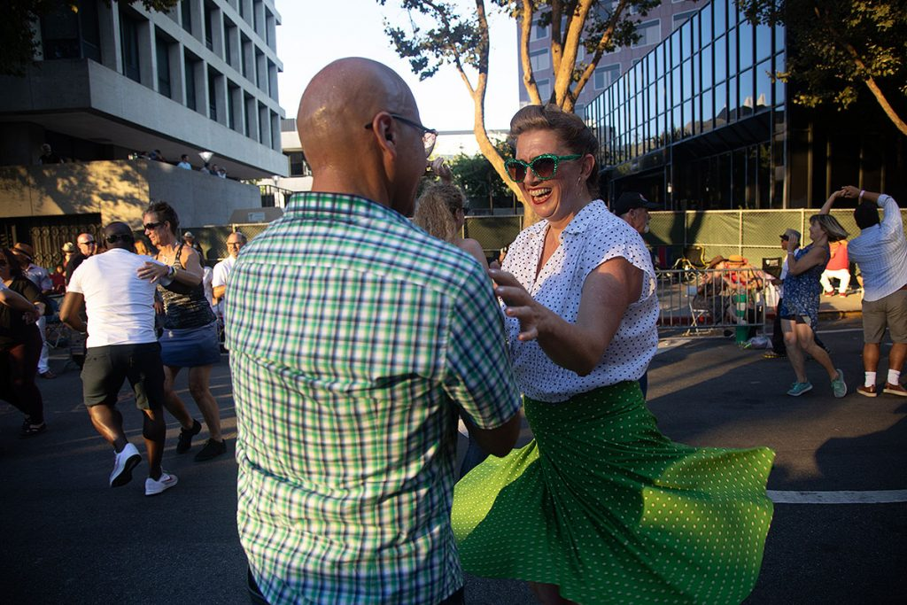 """A perennial Summer Fest """"hot spot"""" is the Salsa Stage with fest-goers swaying and twirling in the downtown streets. Photo by Robert Birnbach"""